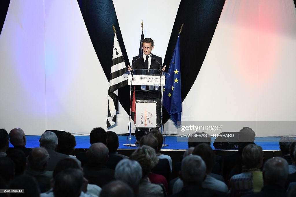 Former French president and head of the right-wing opposition party 'Les Republicains' (The Republicans) Nicolas Sarkozy delivers a speech during a meeting for the 'Fete de la federation des Republicains - Celebration of the federation of the Republicains ' on June 26, 2016 in Chartres-de-Bretagne, near Rennes, western France. / AFP / JEAN