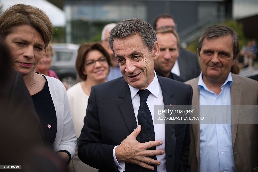 Former French president and head of the right-wing opposition party 'Les Republicains' (The Republicans) Nicolas Sarkozy arrives at a meeting for the 'Fete de la federation des Republicains - Celebration of the federation of the Republicains ' on June 26, 2016 in Chartres-de-Bretagne, near Rennes, western France. / AFP / JEAN