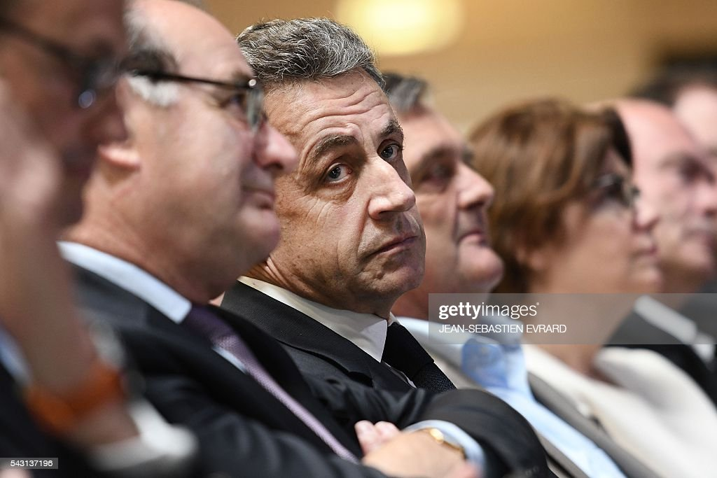 Former French president and head of the right-wing opposition party 'Les Republicains' (The Republicans) Nicolas Sarkozy looks on during a meeting for the 'Fete de la federation des Republicains - Celebration of the federation of the Republicains ' on June 26, 2016 in Chartres-de-Bretagne, near Rennes, western France. / AFP / JEAN