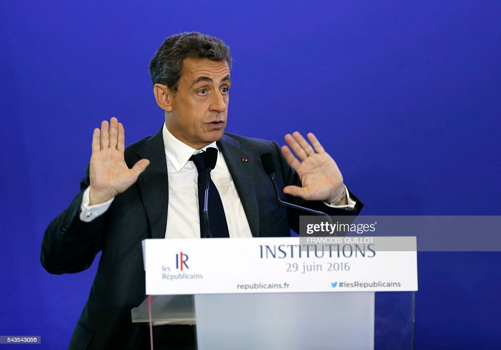 Former French president and head of the right-wing opposition party 'Les Republicains' (The Republicans) Nicolas Sarkozy delivers a speech during a meeting focused on institutions on June 29, 2016 in Paris. GUILLOT