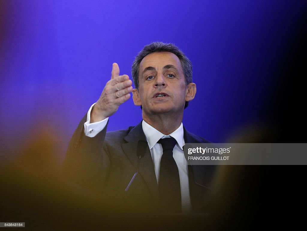 Former French president and head of the right-wing opposition party 'Les Republicains' (The Republicans) Nicolas Sarkozy gestures as he delivers a speech during a meeting focused on institutions on June 29, 2016 in Paris. GUILLOT