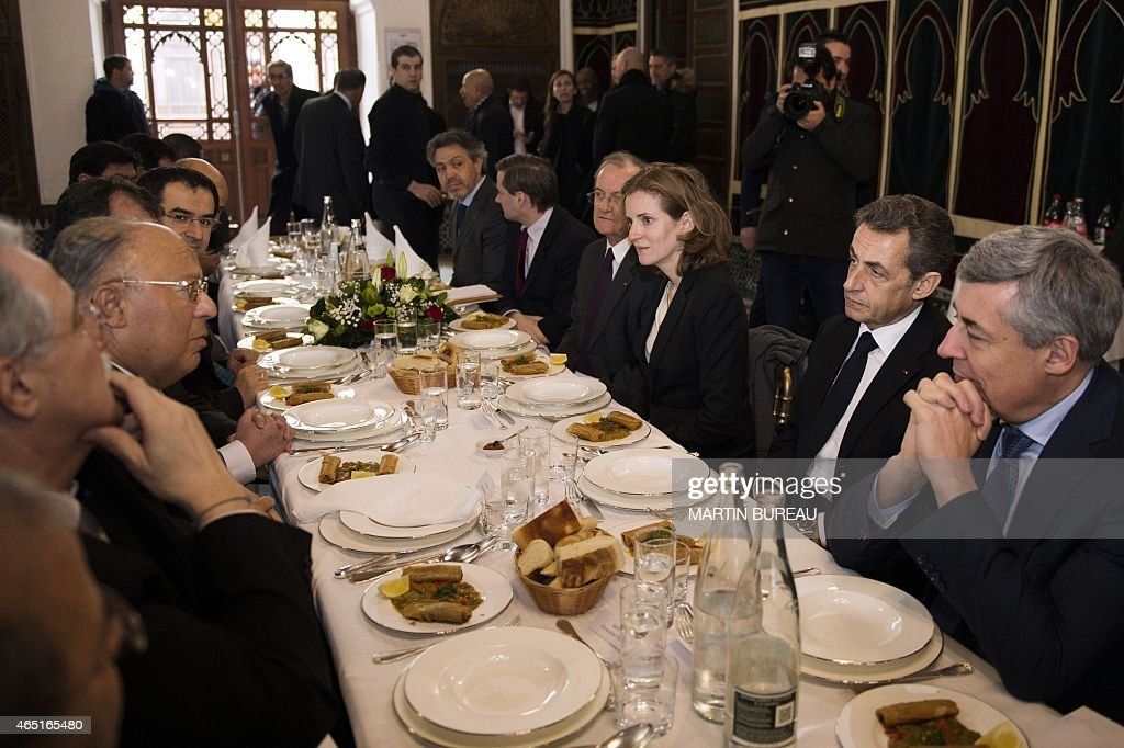 Former French President and head of UMP right-wing party <a gi-track='captionPersonalityLinkClicked' href=/galleries/search?phrase=Nicolas+Sarkozy&family=editorial&specificpeople=211375 ng-click='$event.stopPropagation()'>Nicolas Sarkozy</a> (2ndR), UMP Member of Parliament <a gi-track='captionPersonalityLinkClicked' href=/galleries/search?phrase=Henri+Guaino&family=editorial&specificpeople=4206004 ng-click='$event.stopPropagation()'>Henri Guaino</a> (R), UMP vice-President <a gi-track='captionPersonalityLinkClicked' href=/galleries/search?phrase=Nathalie+Kosciusko-Morizet&family=editorial&specificpeople=2547835 ng-click='$event.stopPropagation()'>Nathalie Kosciusko-Morizet</a> (3rdR) attend a lunch with <a gi-track='captionPersonalityLinkClicked' href=/galleries/search?phrase=Dalil+Boubakeur&family=editorial&specificpeople=539922 ng-click='$event.stopPropagation()'>Dalil Boubakeur</a> (2ndL), Rector of the Great Mosque of Paris and President of the French Council of Muslim Faith (CFCM), on March 3, 2015 at the Great Mosque of Paris.