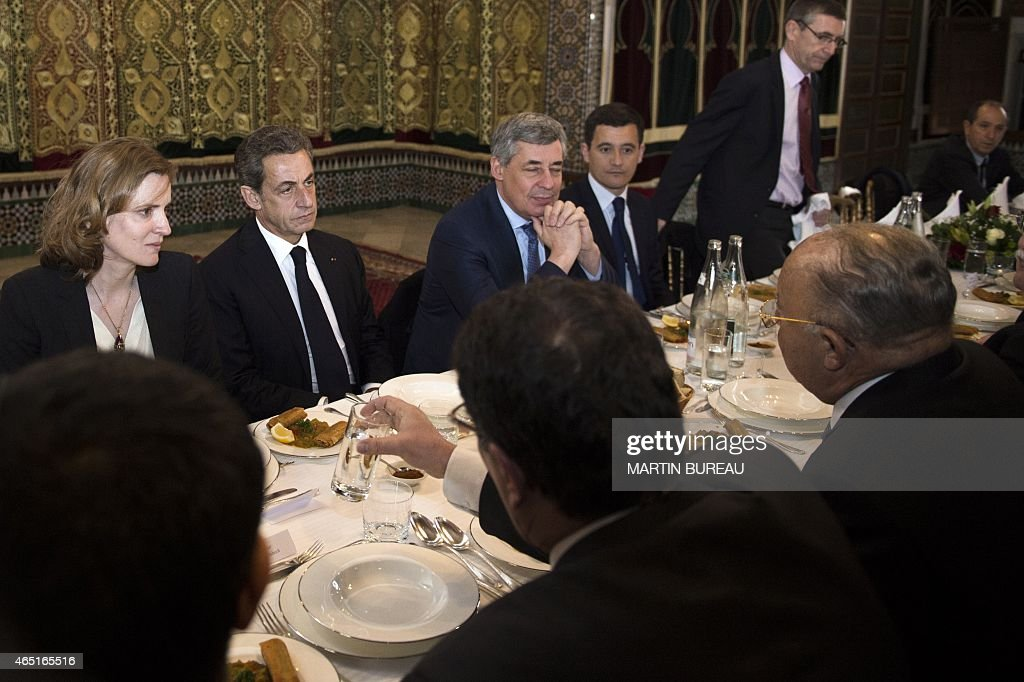 Former French President and head of UMP right-wing party <a gi-track='captionPersonalityLinkClicked' href=/galleries/search?phrase=Nicolas+Sarkozy&family=editorial&specificpeople=211375 ng-click='$event.stopPropagation()'>Nicolas Sarkozy</a> (2ndL), UMP vice-President <a gi-track='captionPersonalityLinkClicked' href=/galleries/search?phrase=Nathalie+Kosciusko-Morizet&family=editorial&specificpeople=2547835 ng-click='$event.stopPropagation()'>Nathalie Kosciusko-Morizet</a> (L) and UMP Member of Parliament <a gi-track='captionPersonalityLinkClicked' href=/galleries/search?phrase=Henri+Guaino&family=editorial&specificpeople=4206004 ng-click='$event.stopPropagation()'>Henri Guaino</a> (3rdL) attend a lunch with <a gi-track='captionPersonalityLinkClicked' href=/galleries/search?phrase=Dalil+Boubakeur&family=editorial&specificpeople=539922 ng-click='$event.stopPropagation()'>Dalil Boubakeur</a> (R), Rector of the Great Mosque of Paris and President of the French Council of Muslim Faith (CFCM), on March 3, 2015 at the Great Mosque of Paris.