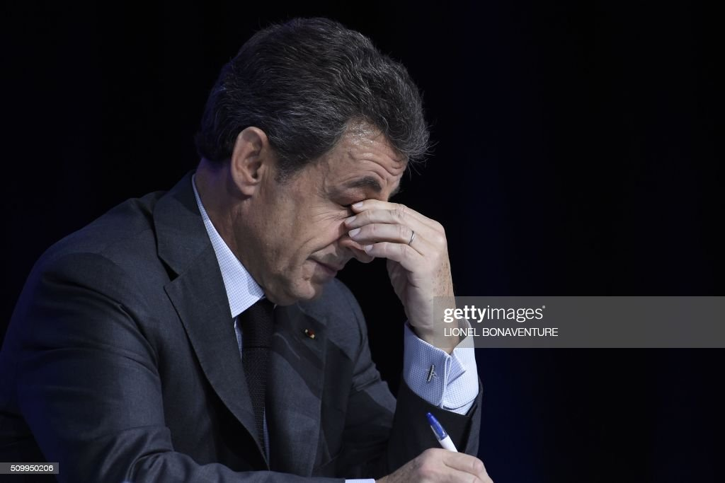 Former French president and Les Republicains (LR) right-wing main opposition party's leader Nicolas Sarkozy wipes his eyes during the LR National Council on February 13, 2016 in Paris. AFP PHOTO / LIONEL BONAVENTURE / AFP / LIONEL BONAVENTURE