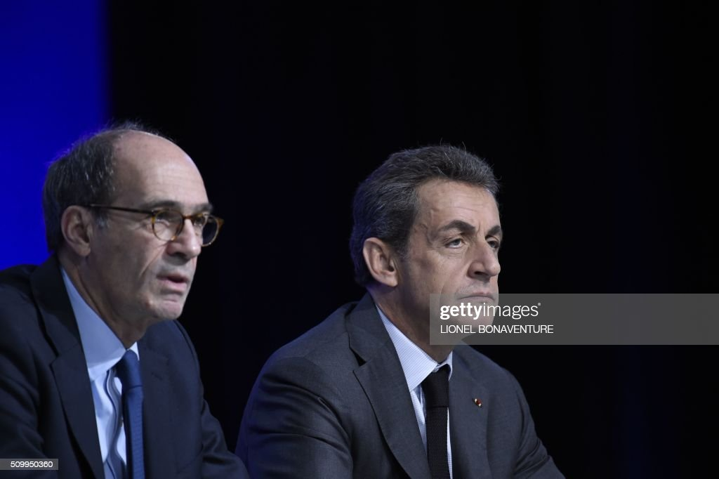 Former French president and Les Republicains (LR) right-wing main opposition party's leader Nicolas Sarkozy (R) and LR party member Eric Woerth attend the LR National Council on February 13, 2016 in Paris. AFP PHOTO / LIONEL BONAVENTURE / AFP / LIONEL BONAVENTURE