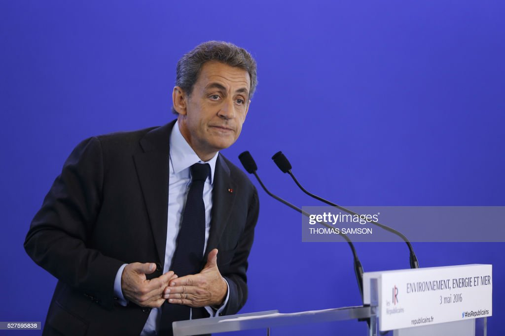 Former French president and President of France's right-wing Les Republicains (LR) Nicolas Sarkozy delivers a speech after a meeting on Environment, Seas and Energies, at the party's headquarters in Paris on May 3, 2016. / AFP / THOMAS