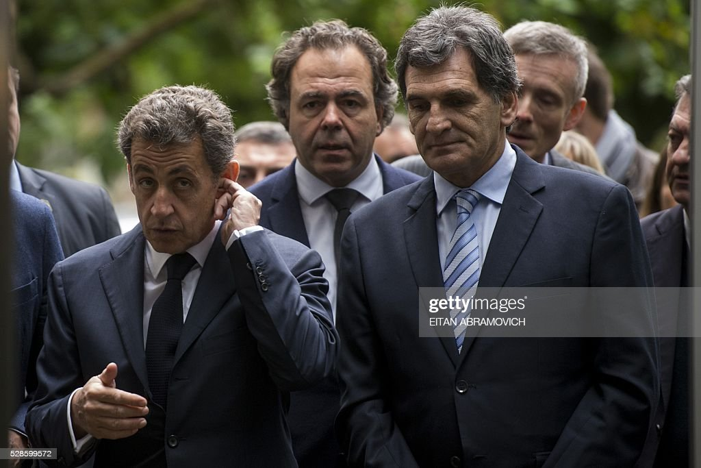 Former French president and president of France's right-wing Les Republicains (LR) party Nicolas Sarkozy (L) walks next to Human Rights Secretary Claudio Avruj at the entrance to the officer's mess at the former clandestine detention center of the Navy School (ESMA) in Buenos, Argentina, on May 06, 2016. Some 30,000 people were 'disappeared' under the military regime that ruled Argentina from 1976 to 1983, according to human rights organizations. Some 30,000 people were disappeared under the military regime that ruled Argentina from 1976 to 1983, according to human rights organizations. / AFP / EITAN