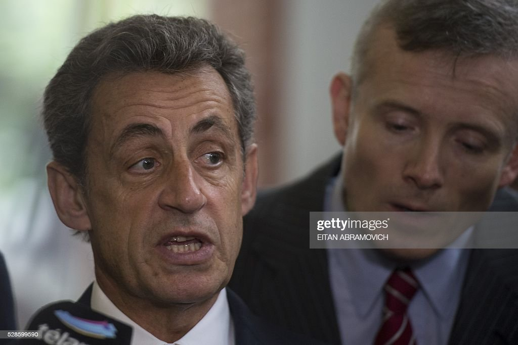 Former French president and president of France's right-wing Les Republicains (LR) party Nicolas Sarkozy speaks after a visit to the former clandestine detention center of the Navy School (ESMA) in Buenos, Argentina, on May 06, 2016. Some 30,000 people were disappeared under the military regime that ruled Argentina from 1976 to 1983, according to human rights organizations. / AFP / EITAN