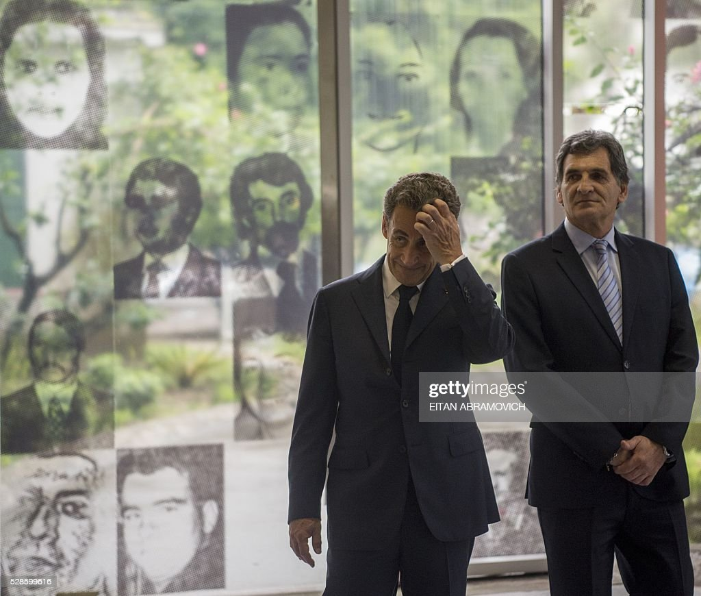 Former French president and president of France's right-wing Les Republicains (LR) party Nicolas Sarkozy (L) gestures next to Human Rights Secretary Claudio Avruj at the entrance to the officer's mess at the former clandestine detention center of the Navy School (ESMA) in Buenos, Argentina, on May 06, 2016. Some 30,000 people were 'disappeared' under the military regime that ruled Argentina from 1976 to 1983, according to human rights organizations. Some 30,000 people were disappeared under the military regime that ruled Argentina from 1976 to 1983, according to human rights organizations. / AFP / EITAN