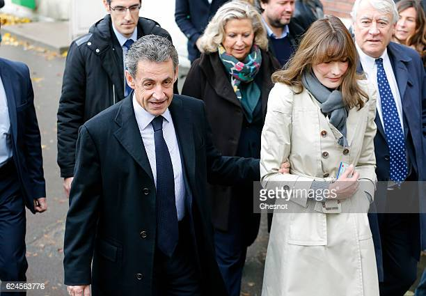 Former French President and presidential candidate hopeful Nicolas Sarkozy and his wife Carla BruniSarkozy leave after casting their votes during the...