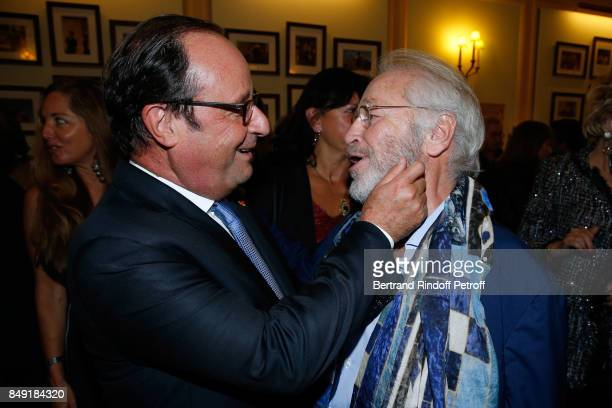 Former French President Francois Hollande and actor of the piece Bernard Murat attend 'La vraie vie' Theater Play at Theatre Edouard VII on September...