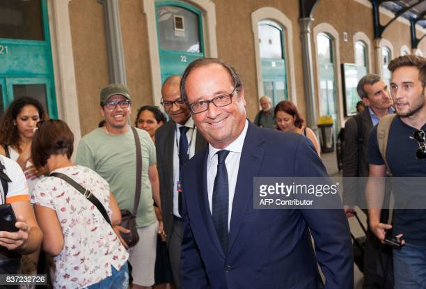 Former French president Francois Hollande looks on as he arrives at the train station on August 22 2017 in Angouleme during the 10th francophone film...