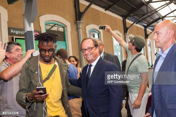 Former French president Francois Hollande looks on as he arrives at the train station in Angouleme on August 22 2017 during the 10th francophone film...