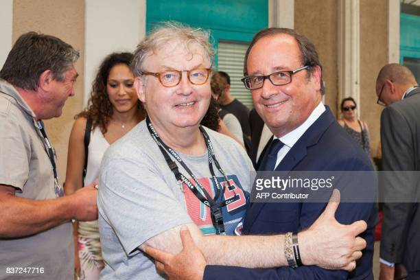 Former French president Francois Hollande pose with French actor and producer Dominique Besnehard as he arrives at the train station in Angouleme on...