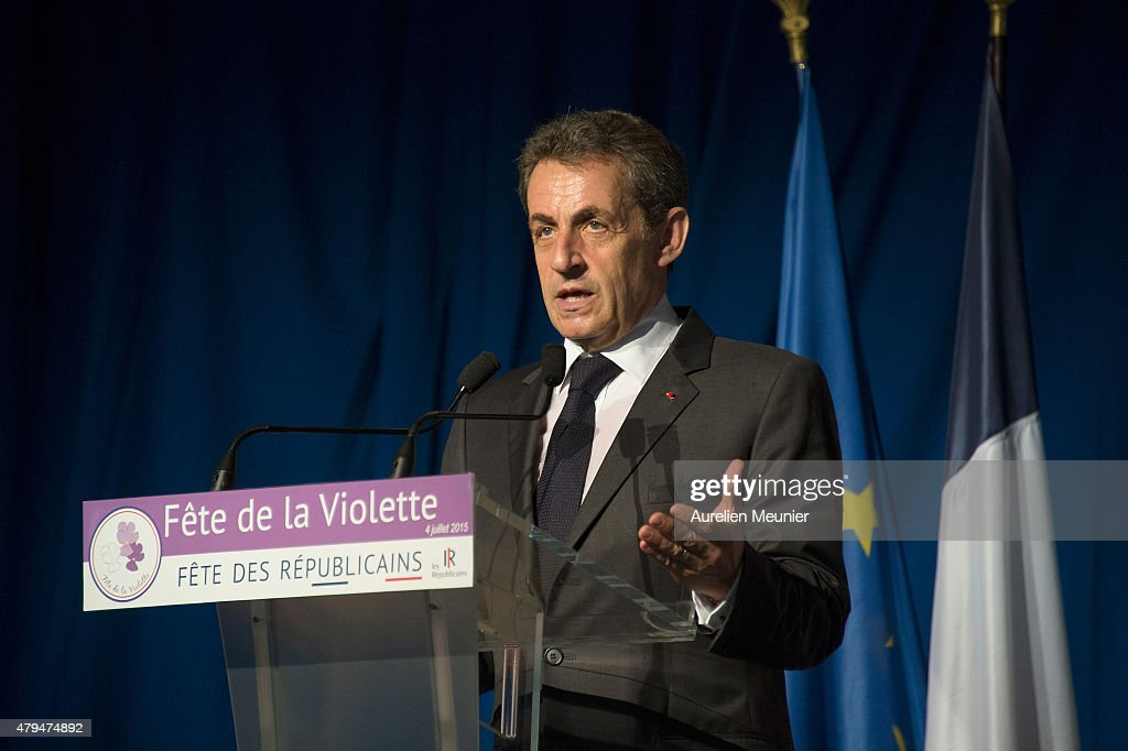 Former French President Nicolas Sarkozy addresses thousands of political supporters during a speech at La Fete de la Violette on July 4, 2015 in La Ferte-Imbault, France. The political meeting organised by the militants of La Droite Forte (the right wing of Les Republicains party) for Nicolas Sarkozy to talk about Greek Prime Minister Alexis Tsipras and French politics in general.