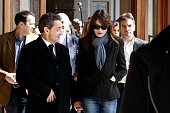 Former French President Nicolas Sarkozy and Carla BruniSarkozy arrive to vote on March 23 2014 in Paris France Municipal elections are taking place...