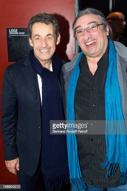 Former French President Nicolas Sarkozy (L) and conductor/pianist Frederic Manoukian pose in French impersonator Laurent Gerra's dressing room following Gerra's one man show at Olympia hall on December 26, 2012 in Paris, France.