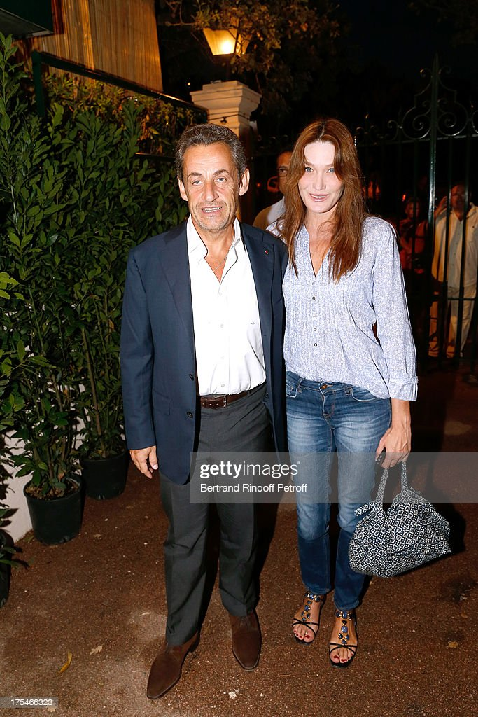 Former French President Nicolas Sarkozy and his wife singer <a gi-track='captionPersonalityLinkClicked' href=/galleries/search?phrase=Carla+Bruni&family=editorial&specificpeople=235729 ng-click='$event.stopPropagation()'>Carla Bruni</a> attend 'Pianistic' Concert of singer Julien Clerc at at 29th Ramatuelle Festival : Day 4 on August 3, 2013 in Ramatuelle, France.