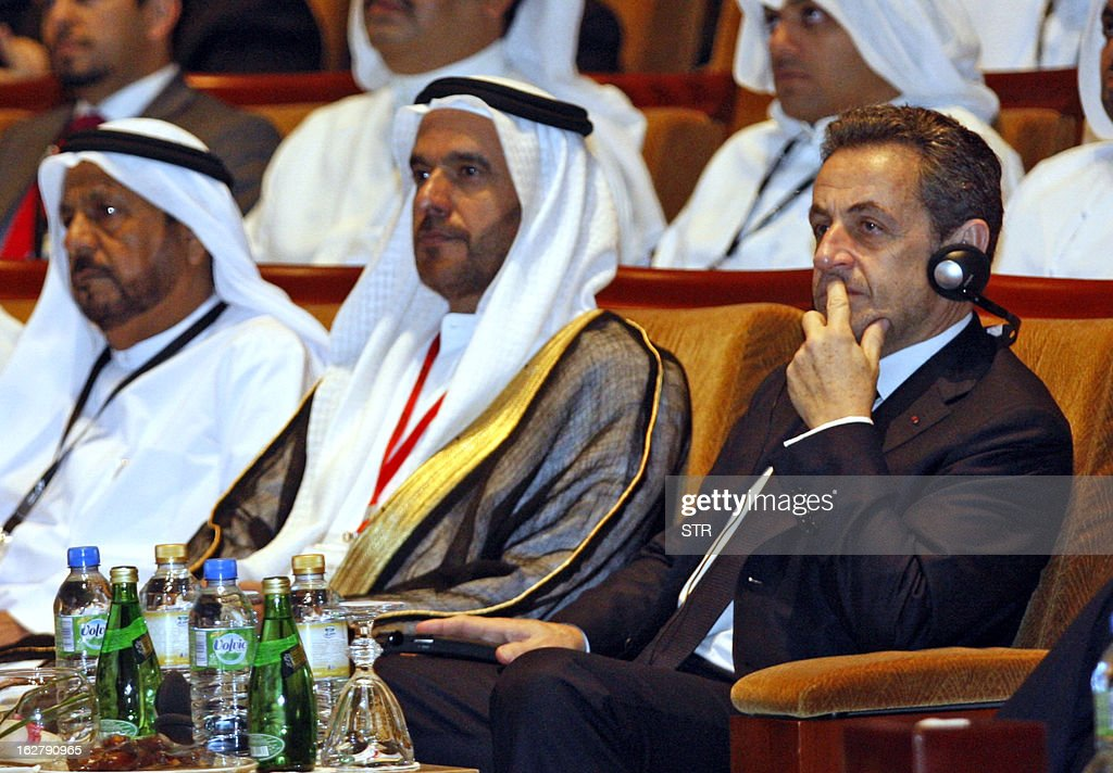 Former French president Nicolas Sarkozy (R) and Nasser Ahmed Al Sowaidi (C) chairman of the Abu Dhabi Department of Economic Development and National Bank of Abu Dhabi attend the Global Financial Markets Forum at the Emirates Palace in Abu Dhabi on February 27, 2013.