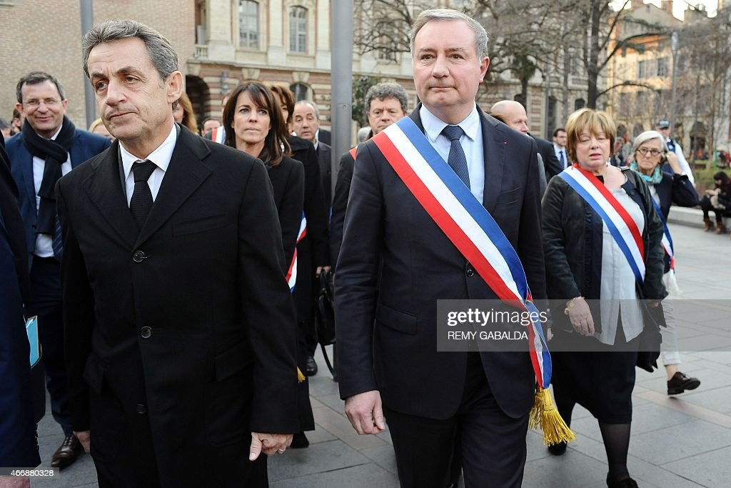Former French President <a gi-track='captionPersonalityLinkClicked' href=/galleries/search?phrase=Nicolas+Sarkozy&family=editorial&specificpeople=211375 ng-click='$event.stopPropagation()'>Nicolas Sarkozy</a> (L) and Toulouse mayor Jean-Luc Moudenc attend a commemoration ceremony for the victims of French jihadist gunman Mohamed Merah, in Toulouse on March 19, 2015. Merah shot dead three soldiers in southern France in 2012 before killing three students and a teacher at a Jewish school more than a week later. AFP PHOTO / REMY GABALDA