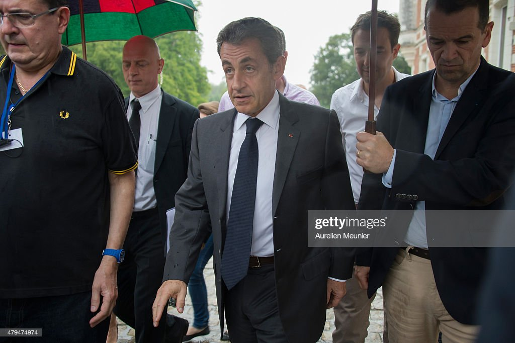 Former French President Nicolas Sarkozy arrives to addresse thousands of political supporters during a speech at La Fete de la Violette on July 4, 2015 in La Ferte-Imbault, France. The political meeting organised by the militants of La Droite Forte (the right wing of Les Republicains party) for Nicolas Sarkozy to talk about Greek Prime Minister Alexis Tsipras and French politics in general.