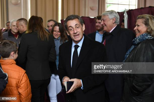 Former French president Nicolas Sarkozy arrives to cast his ballot at a polling station in Paris on May 7 during the second round of the French...
