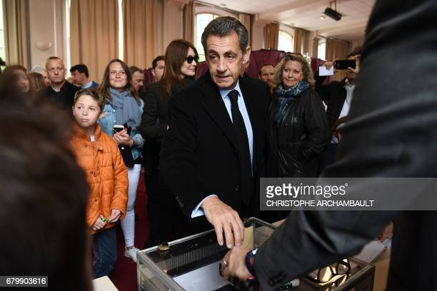 Former French president Nicolas Sarkozy casts his ballot at a polling station in Paris on May 7 during the second round of the French presidential...