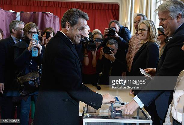 Former French President Nicolas Sarkozy casts his vote on March 23 2014 in Paris France Municipal elections are taking place today in Paris and on...