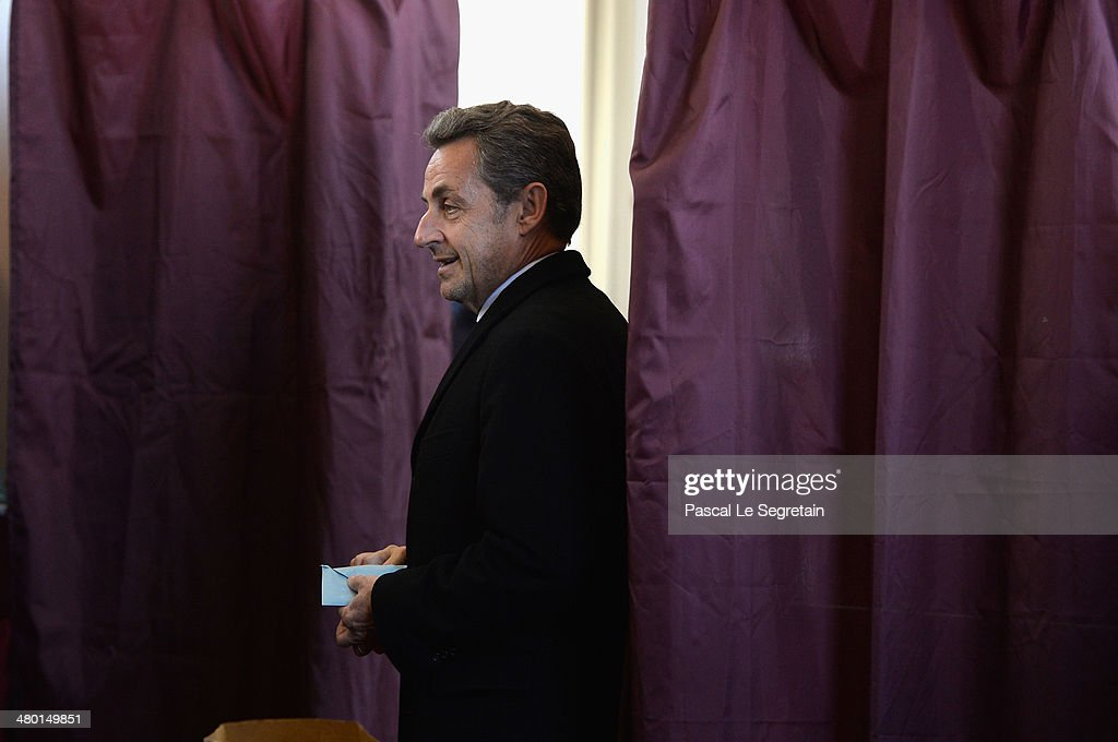 Former French President <a gi-track='captionPersonalityLinkClicked' href=/galleries/search?phrase=Nicolas+Sarkozy&family=editorial&specificpeople=211375 ng-click='$event.stopPropagation()'>Nicolas Sarkozy</a> gets out from the Polling booth on March 23, 2014 in Paris, France. Municipal elections are taking place today in Paris and on March 30.
