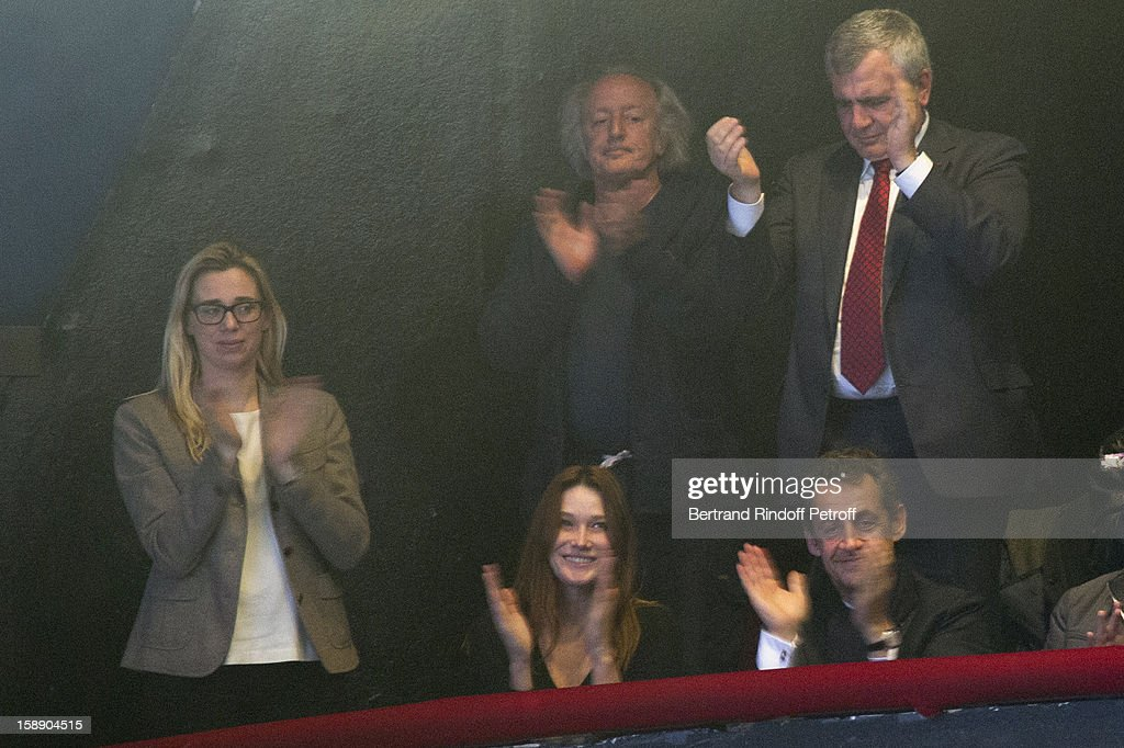 Former French President Nicolas Sarkozy (Foreground R), his wife Carla Bruni-Sarkozy (Foreground C), lawyer Thierry herzog (Rear R), singer Didier Barbelivien (Rear C) and Barbelivien's companion Laure attend French impersonator Laurent Gerra's one man show at Olympia hall on December 26, 2012 in Paris, France.