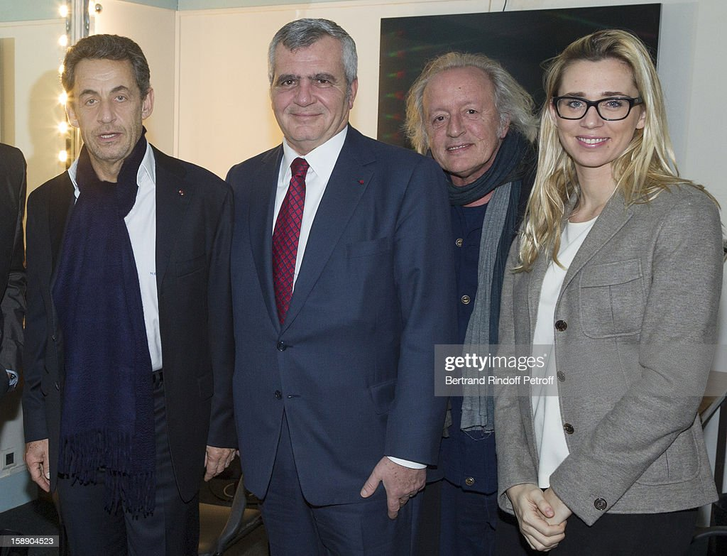 Former French President <a gi-track='captionPersonalityLinkClicked' href=/galleries/search?phrase=Nicolas+Sarkozy&family=editorial&specificpeople=211375 ng-click='$event.stopPropagation()'>Nicolas Sarkozy</a> (Foreground R), lawyer Thierry Herzog, singer Didier Barbelivien and Barbelivien's companion Laure pose in French impersonator Laurent Gerra's dressing room foolowing Gerra's one man show at Olympia hall on December 26, 2012 in Paris, France.