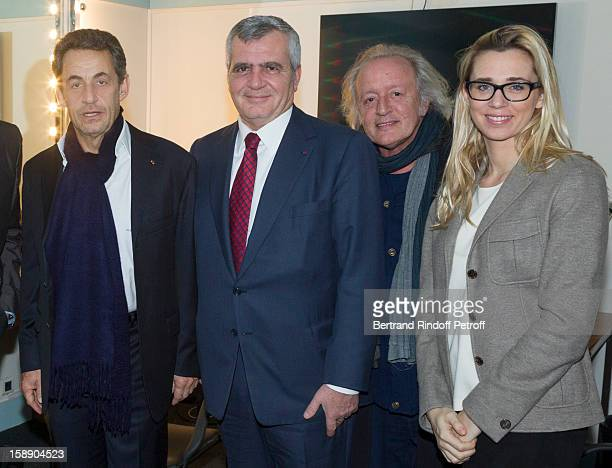 Former French President Nicolas Sarkozy (Foreground R), lawyer Thierry Herzog, singer Didier Barbelivien and Barbelivien's companion Laure pose in French impersonator Laurent Gerra's dressing room foolowing Gerra's one man show at Olympia hall on December 26, 2012 in Paris, France.