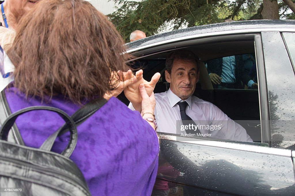 Former French President Nicolas Sarkozy leaves after he addressed thousands of political supporters during a speech at La Fete de la Violette on July 4, 2015 in La Ferte-Imbault, France. The political meeting organised by the militants of La Droite Forte (the right wing of Les Republicains party) for Nicolas Sarkozy to talk about Greek Prime Minister Alexis Tsipras and French politics in general.