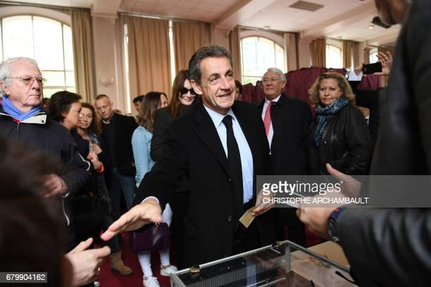 Former French president Nicolas Sarkozy prepares to cast his ballot at a polling station in Paris on May 7 during the second round of the French...