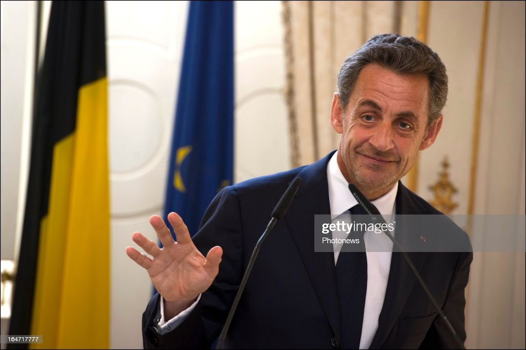 Former French president <a gi-track='captionPersonalityLinkClicked' href=/galleries/search?phrase=Nicolas+Sarkozy&family=editorial&specificpeople=211375 ng-click='$event.stopPropagation()'>Nicolas Sarkozy</a> presents the Legion d'Honneur to Belgian Minister of Foreign Affairs Didier Reynders on March 27, 2013 in Brussels, Belgium.