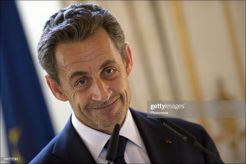 Former French president Nicolas Sarkozy presents the Legion d'Honneur to Belgian Minister of Foreign Affairs Didier Reynders on March 27, 2013 in Brussels, Belgium.
