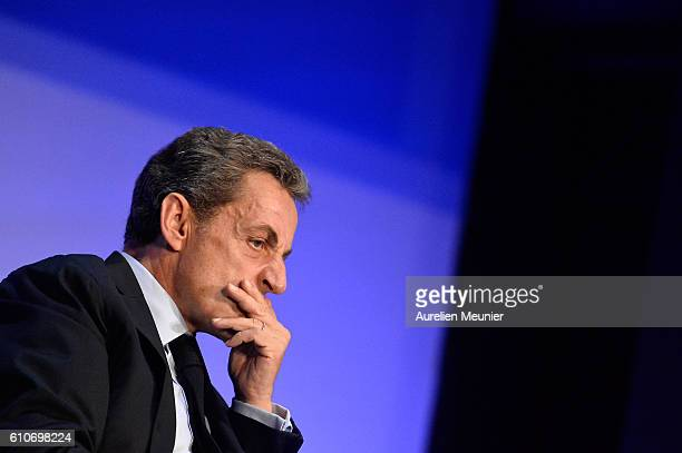 Former French President Nicolas Sarkozy reacts during the Rightwing Opposition Party 'Les Republicains' primary elections meeting on September 27...
