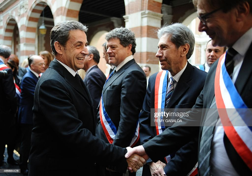 Former French President <a gi-track='captionPersonalityLinkClicked' href=/galleries/search?phrase=Nicolas+Sarkozy&family=editorial&specificpeople=211375 ng-click='$event.stopPropagation()'>Nicolas Sarkozy</a> (L) shakes hands with Toulouse deputy mayors and town councillors during a commemoration ceremony for the victims of French jihadist gunman Mohamed Merah, in Toulouse on March 19, 2015. Merah shot dead three soldiers in southern France in 2012 before killing three students and a teacher at a Jewish school more than a week later. AFP PHOTO / REMY GABALDA