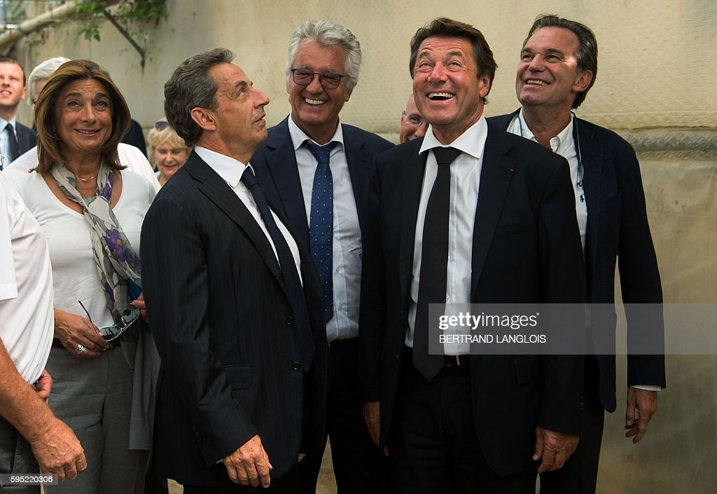 Former French president Nicolas Sarkozy shares a laugh with the president of the ProvenceAlpesCoted'Azur region and former mayor of Nice Christian...