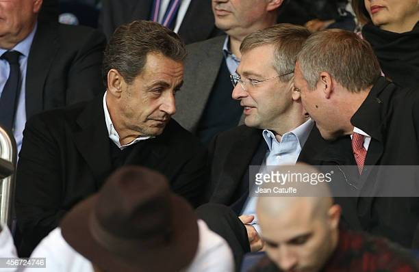 Former French President Nicolas Sarkozy talks with president of AS Monaco Dmitry Rybolovlev and vicepresident of AS Monaco Vadim Vasilyev during the...