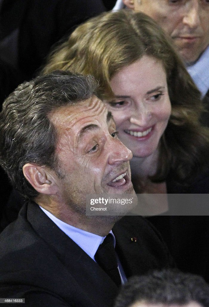 Former French President <a gi-track='captionPersonalityLinkClicked' href=/galleries/search?phrase=Nicolas+Sarkozy&family=editorial&specificpeople=211375 ng-click='$event.stopPropagation()'>Nicolas Sarkozy</a> waves as he leaves a campaign meeting with French right-wing UMP party mayoral candidate <a gi-track='captionPersonalityLinkClicked' href=/galleries/search?phrase=Nathalie+Kosciusko-Morizet&family=editorial&specificpeople=2547835 ng-click='$event.stopPropagation()'>Nathalie Kosciusko-Morizet</a> on February 10, 2014 in Paris, France. The former French President attended a meeting to show his support for <a gi-track='captionPersonalityLinkClicked' href=/galleries/search?phrase=Nathalie+Kosciusko-Morizet&family=editorial&specificpeople=2547835 ng-click='$event.stopPropagation()'>Nathalie Kosciusko-Morizet</a> for the upcoming March 2014 election for the Mayor of Paris.