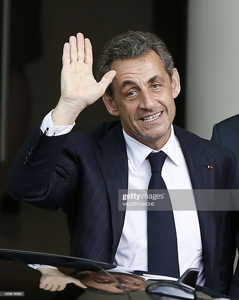 Former French president <a gi-track='captionPersonalityLinkClicked' href=/galleries/search?phrase=Nicolas+Sarkozy&family=editorial&specificpeople=211375 ng-click='$event.stopPropagation()'>Nicolas Sarkozy</a> waves as he leaves the Fairmont Hotel after giving a private conference on June 18, 2014 in Monaco. AFP PHOTO / VALERY HACHE