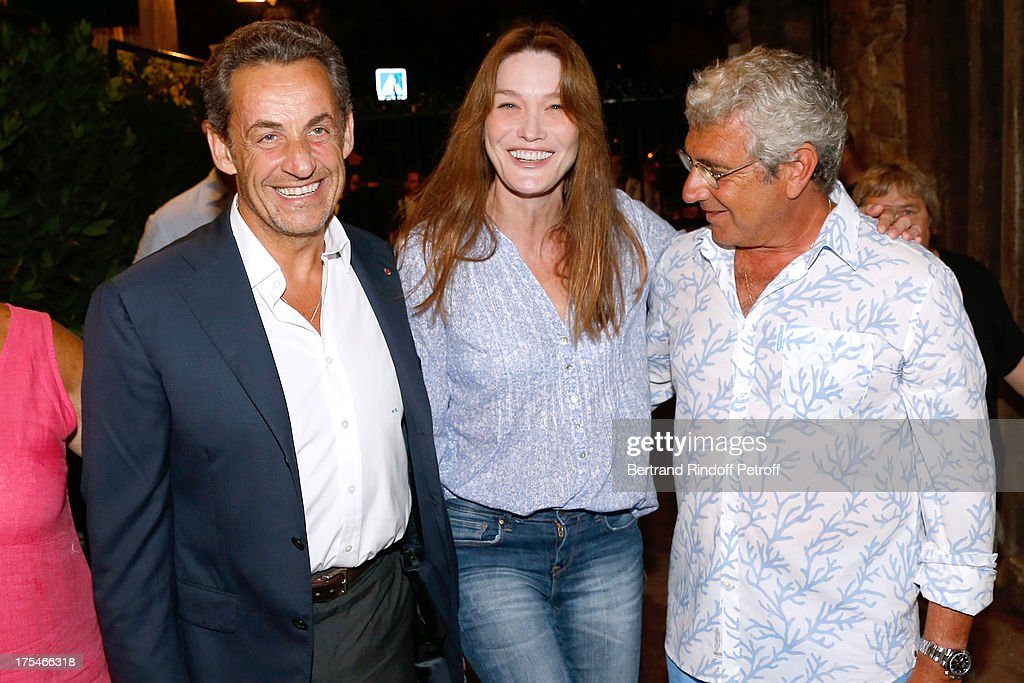 Former French President <a gi-track='captionPersonalityLinkClicked' href=/galleries/search?phrase=Nicolas+Sarkozy&family=editorial&specificpeople=211375 ng-click='$event.stopPropagation()'>Nicolas Sarkozy</a> with his wife singer <a gi-track='captionPersonalityLinkClicked' href=/galleries/search?phrase=Carla+Bruni&family=editorial&specificpeople=235729 ng-click='$event.stopPropagation()'>Carla Bruni</a> and Artistic Director of the Festival <a gi-track='captionPersonalityLinkClicked' href=/galleries/search?phrase=Michel+Boujenah&family=editorial&specificpeople=1027167 ng-click='$event.stopPropagation()'>Michel Boujenah</a> attend 'Pianistic' Concert of singer Julien Clerc at at 29th Ramatuelle Festival : Day 4 on August 3, 2013 in Ramatuelle, France.