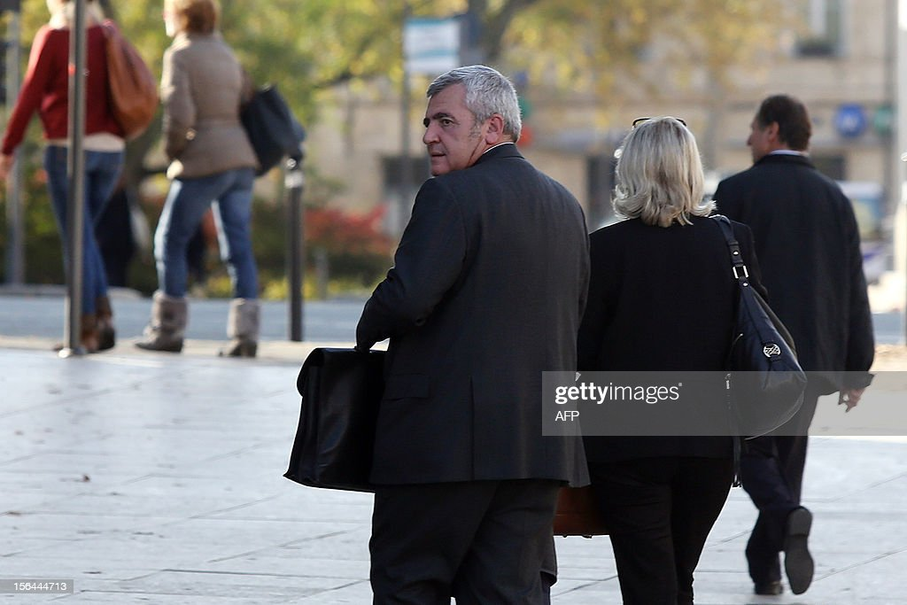 Former French President Nicolas Sarkozy's lawyer Thierry Herzog (L) arrives at Bordeaux's courthouse, in southwestern France, on November 15, 2012, prior to meet the investigating judges as part of the so-called Bettencourt case. The case including allegations of tax evasion and illegal campaign funding caused embarrassment to Sarkozy's government, after L'Oreal heiress Liliane Bettencourt's former accountant revealed that right-wing UMP party had alledgedly received illegal funding.