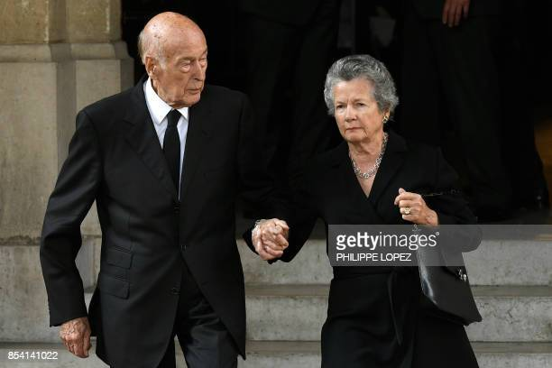 Former French President Valery Giscard d'Estaing and his wife AnneAymone leave after attending the funeral of L'Oreal heiress Liliane Bettencourt on...