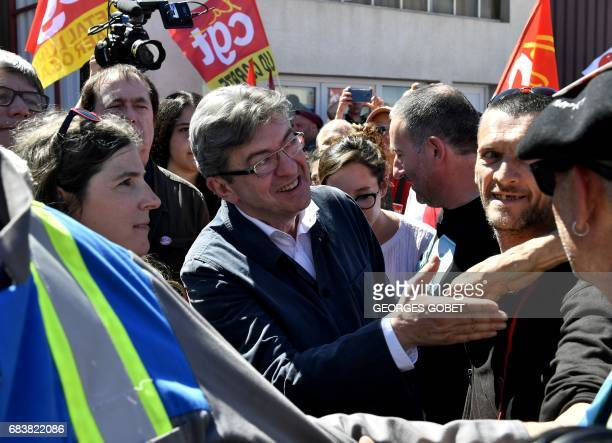 Former French presidential election candidate for the farleft coalition La France insoumise JeanLuc Melenchon shakes hands with an employee of the...