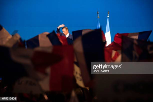 Former French presidential election candidate for the rightwing Debout la France party Nicolas DupontAignan gestures as he delivers a speech during a...