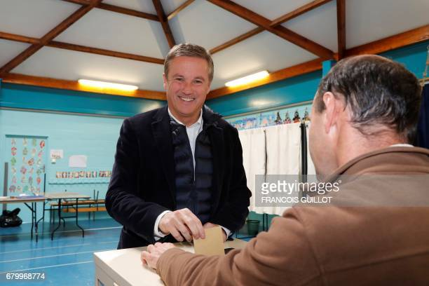 Former French presidential election candidate for the rightwing Debout la France party Nicolas DupontAignan casts his ballot at a polling station in...