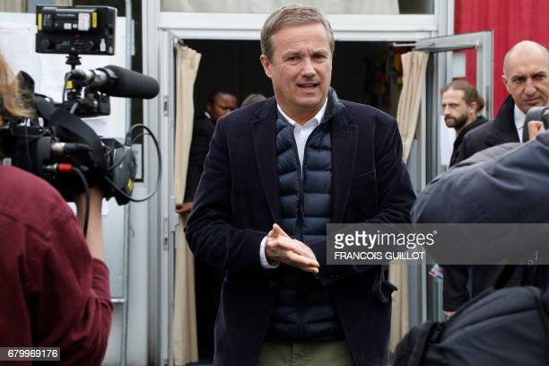 Former French presidential election candidate for the rightwing Debout la France party Nicolas DupontAignan walks out a polling station after casting...