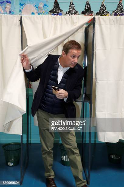 Former French presidential election candidate for the rightwing Debout la France party Nicolas DupontAignan walks out a polling booth at a polling...